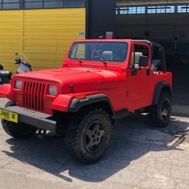 Red Hot Jeep Wrangler LINE-X